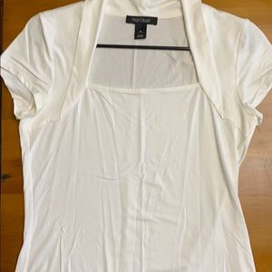 Off-white colored tee. Flattering neckline.